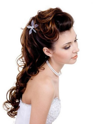 Pretty woman with beautiful wedding hairstyle, long curly hairs - isolated on white